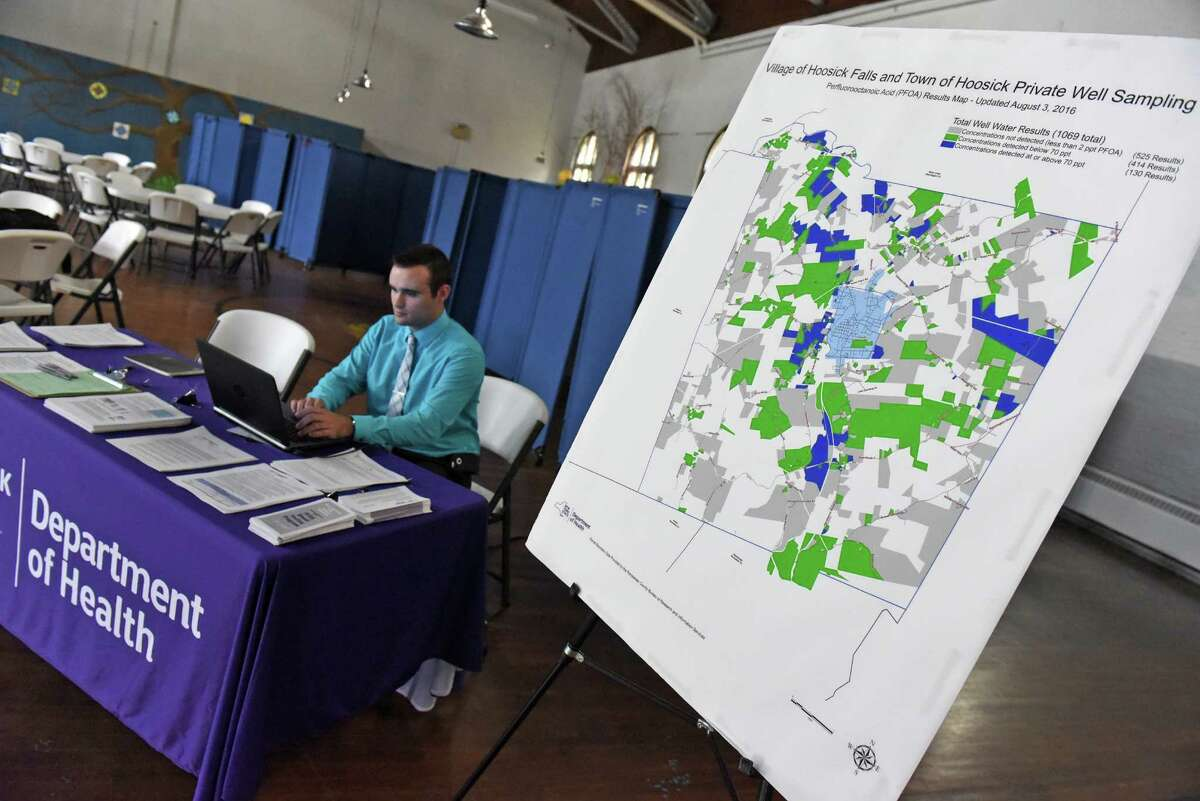 Adam Helman with the New York State Health Department Center for Environmental Health works a public information table to answer questions from the public on PFOA contamination at the Hoosick Falls Armory on Tuesday Aug. 9, 2016 in Hoosick Falls, N.Y. (Michael P. Farrell/Times Union)