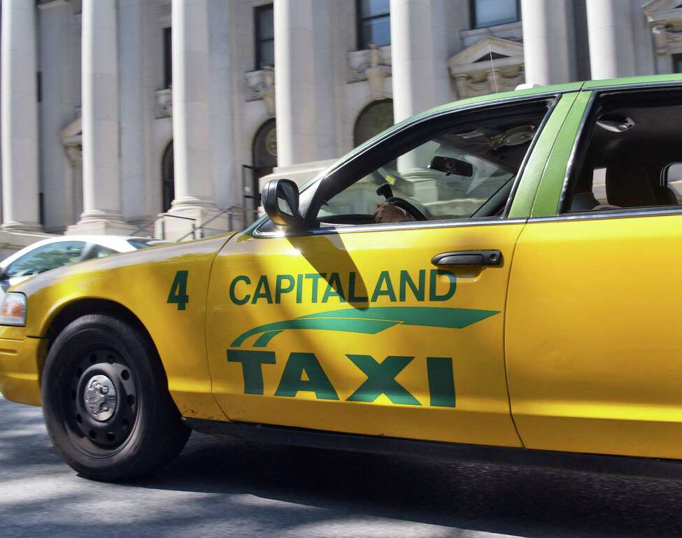 A Capitaland taxi drives past the County Courthouse Tuesday Aug. 9, 2016 in Schenectady, NY. (John Carl D'Annibale / Times Union)