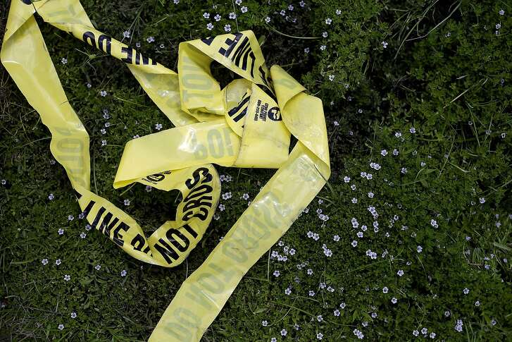 BATON ROUGE, LA - JULY 19: Yellow police crime scene tape rests in the grass on July 19, 2016 in Baton Rouge, Louisiana. The crime scene tape lays in the area where three police officers were killed and several others wounded along Airline Highway Sunday when Gavin Long, who traveled from Kansas City, Missouri, ambushed the law enforcement officers. (Photo by Joshua Lott/Getty Images)
