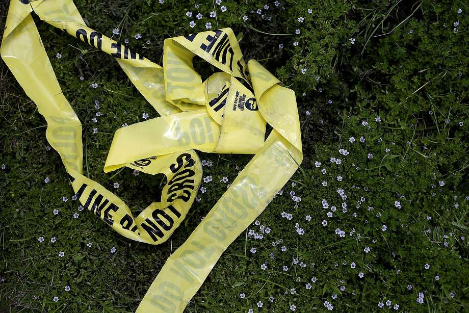 BATON ROUGE, LA - JULY 19: Yellow police crime scene tape rests in the grass on July 19, 2016 in Baton Rouge, Louisiana. The crime scene tape lays in the area where three police officers were killed and several others wounded along Airline Highway Sunday when Gavin Long, who traveled from Kansas City, Missouri, ambushed the law enforcement officers. (Photo by Joshua Lott/Getty Images) Photo: Joshua Lott, Getty Images