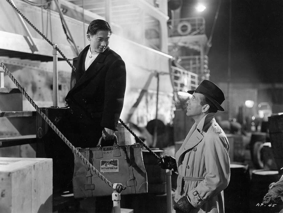 "Roland Got (left), playing a ship's steward, has a few comedic scenes with Humphrey Bogart in ""Across the Pacific"" (1942) after he shows Bogart to his quarters. Photo: Warner Bros. 1942"