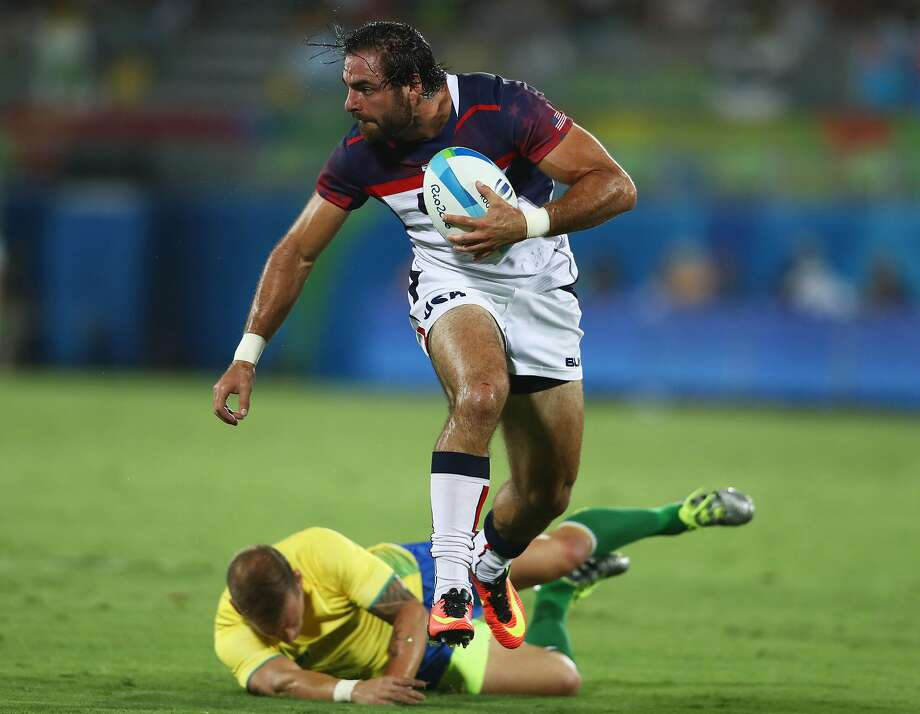 Nate Ebner, a Patriot on the U.S. team, beats Felipe Claro of Brazil to score a try. Photo: David Rogers, Getty Images