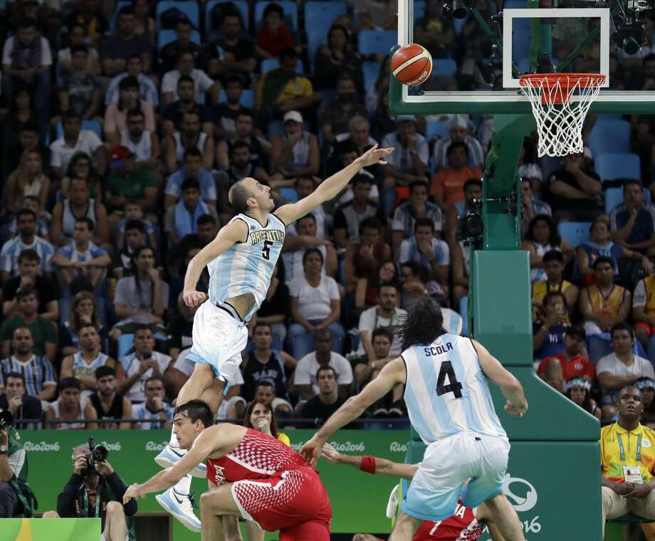 Argentina's Manu Ginobili (5) scores against Croatia during a men's basketball game at the 2016 Summer Olympics in Rio de Janeiro, Brazil, Wednesday, Aug. 10, 2016. (AP Photo/Eric Gay) Photo: Eric Gay/Associated Press