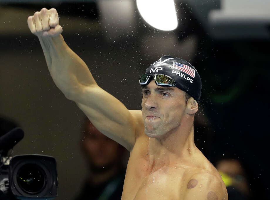 It was another satisfying night for Michael Phelps as he won individual and relay gold medals to bring his career haul to 21. Photo: Michael Sohn, STF / Copyright 2016 The Associated Press. All rights reserved. This material may not be published, broadcast, rewritten or redistribu