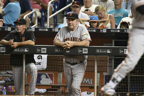 MIAMI, FL - AUGUST 09: Bruce Bochy #15 of the San Francisco Giants watches from the dugout during the game against the Miami Marlins at Marlins Park on August 9, 2016 in Miami, Florida. (Photo by Eric Espada/Getty Images)