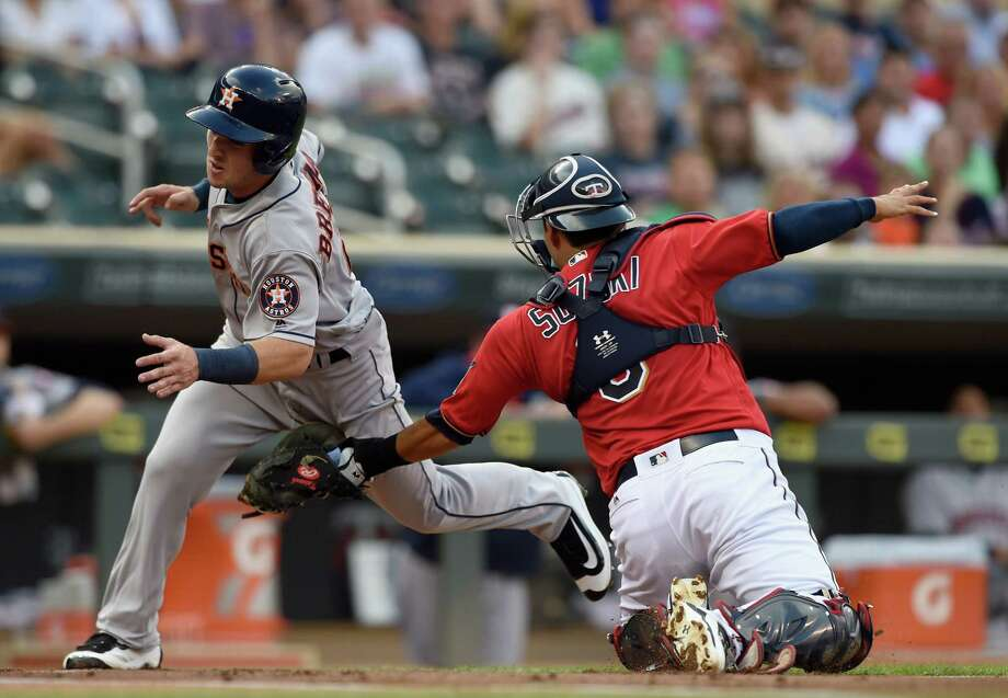 MINNEAPOLIS, MN - AUGUST 09: Alex Bregman #2 of the Houston Astros is out as Kurt Suzuki #8 of the Minnesota Twins defends home plate during the first inning of the game on August 9, 2016 at Target Field in Minneapolis, Minnesota. (Photo by Hannah Foslien/Getty Images) Photo: Hannah Foslien, Stringer / 2016 Getty Images