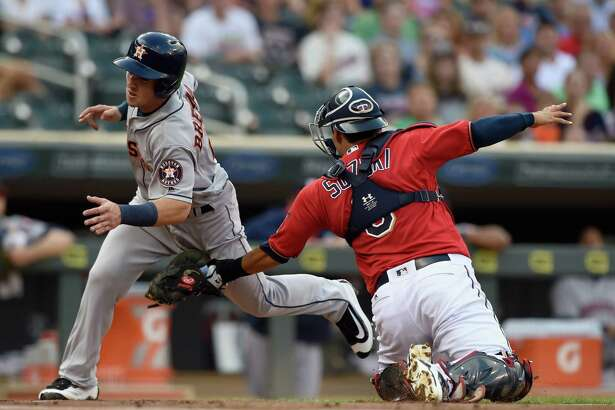 MINNEAPOLIS, MN - AUGUST 09: Alex Bregman #2 of the Houston Astros is out as Kurt Suzuki #8 of the Minnesota Twins defends home plate during the first inning of the game on August 9, 2016 at Target Field in Minneapolis, Minnesota. (Photo by Hannah Foslien/Getty Images)