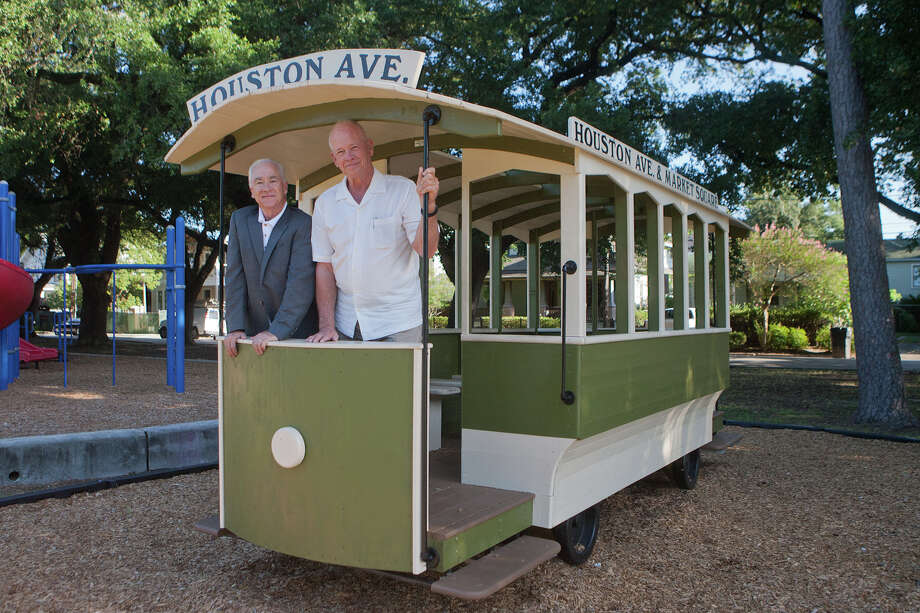 There's a new kid-scale model of one of the old Houston trolleys in Woodland park. These are the guys who put it there.  Pat Rutledge, left, is the treasurer and director of the Friends of Woodland Park, the organization behind the project; and Paul Carr, the artist who built the model. Photo: R. Clayton McKee, Freelance / © R. Clayton McKee