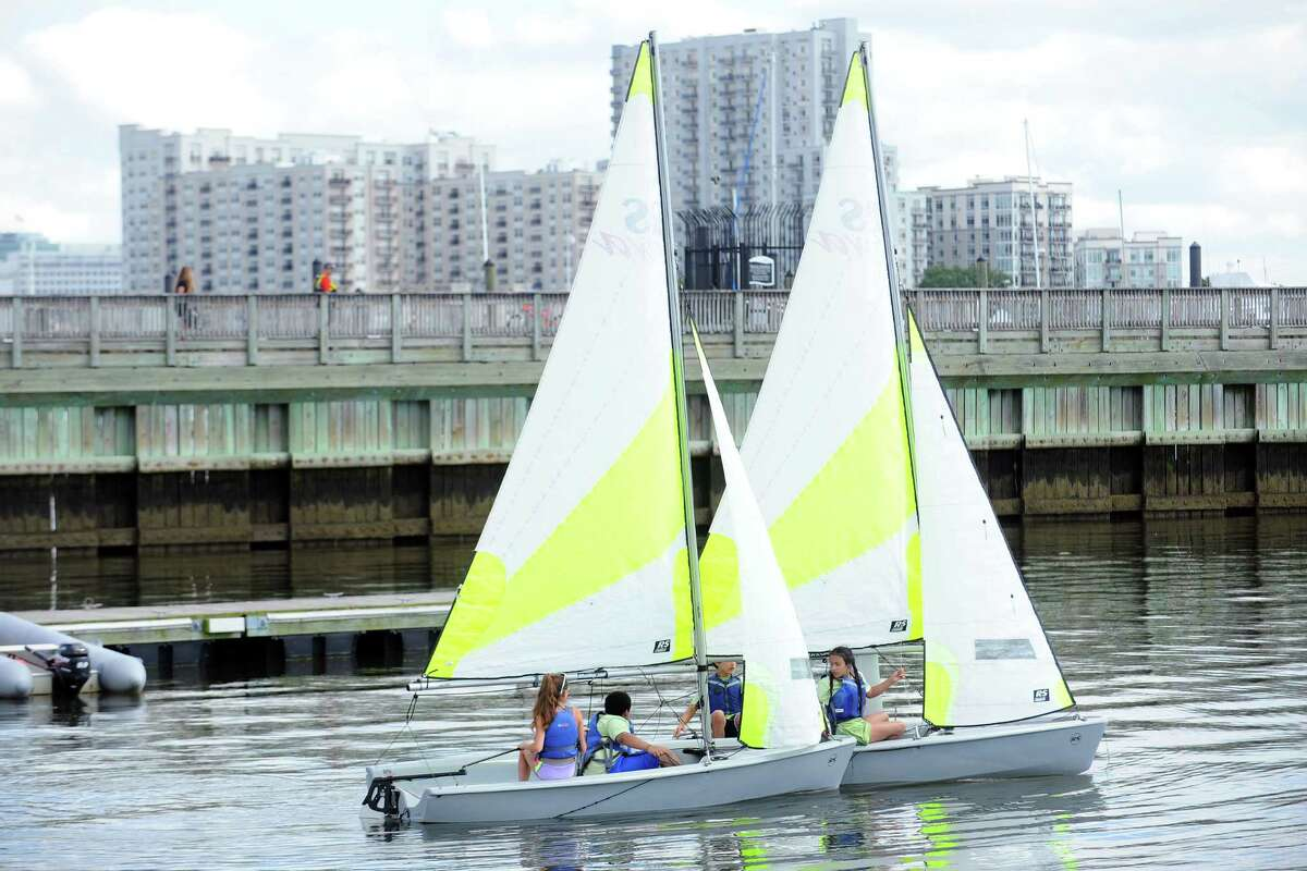 SoundWaters campers sail through the West Branch of Stamford Harbor on Wednesday, June 29, 2016. Soundwaters officially opened its new expanded facility at Boccuzzi Park, which will allow students to study science, technology, engineering and math (STEM) and learn to sail on the site over 10 weeks this summer in Soundwaters Young Mariners STEM program.