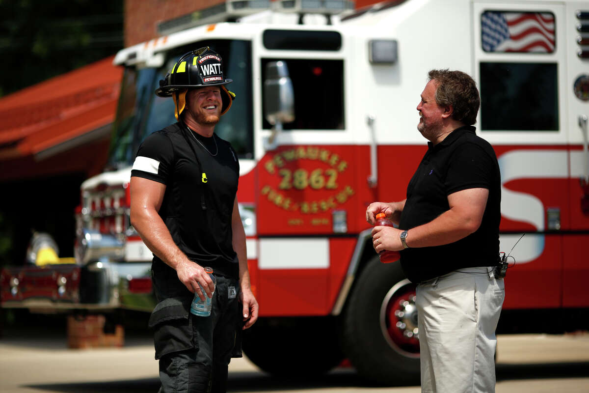 J.J. Watt, Texans The Houston Texans' J.J. Watt went through firefighter training with his father John Watt on behalf of the Gatorade Beat the Heat educational campaign.