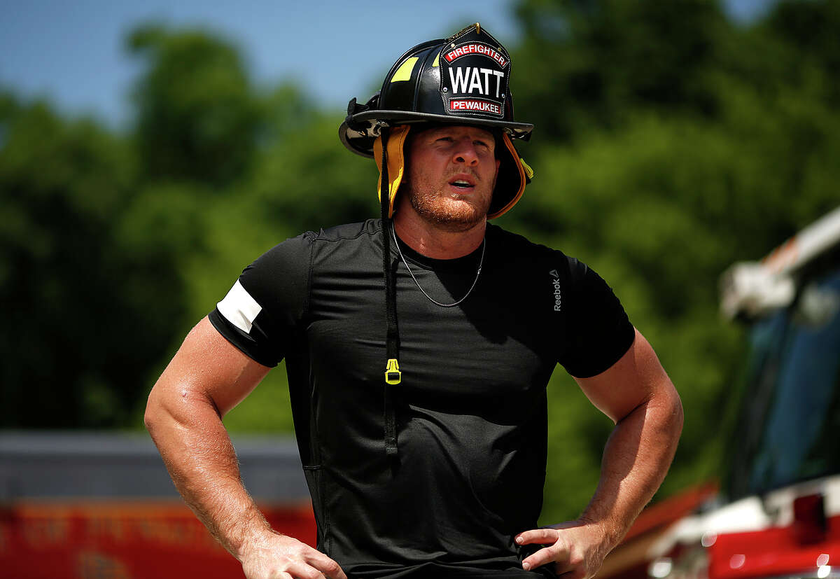 The Houston Texans' J.J. Watt went through firefighter training with his father John Watt on behalf of the Gatorade Beat the Heat educational campaign.