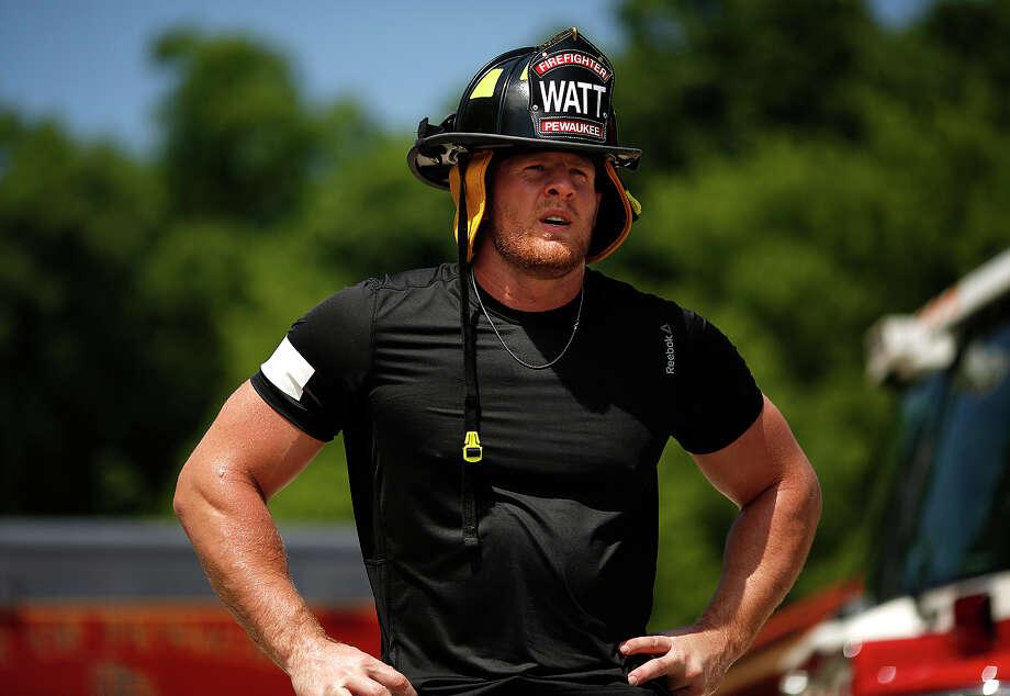 The Houston Texans' J.J. Watt went through firefighter training with his father John Watt on behalf of the Gatorade Beat the Heat educational campaign. Photo: Gatorade
