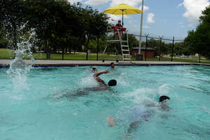 Children swim under the watchful eye of a lifeguard at the Alice Keith Pool in Beaumont on Tuesday. The public pool requires kids pass a swimming test before swimming in the deep end. Photo taken Tuesday 8/9/16 Ryan Pelham/The Enterprise