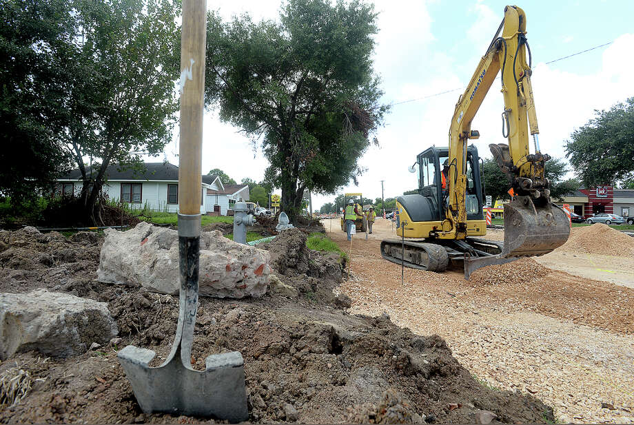 Road crews continue work on the Washington Boulevard road project Tuesday. The project is one of many that city budgets cover. Beaumont  City Council received its proposed 2017 fiscal year budget Tuesday, upon which it will set future public hearings. Photo taken Tuesday, August 9, 2016 Kim Brent/The Enterprise Photo: Kim Brent / Beaumont Enterprise