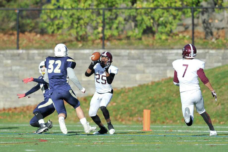 Omar Fortt, right, of St. Luke's, catches a TD pass against King School on Nov. 4. Photo: Michael Cummo / Hearst Connecticut Media / Stamford Advocate