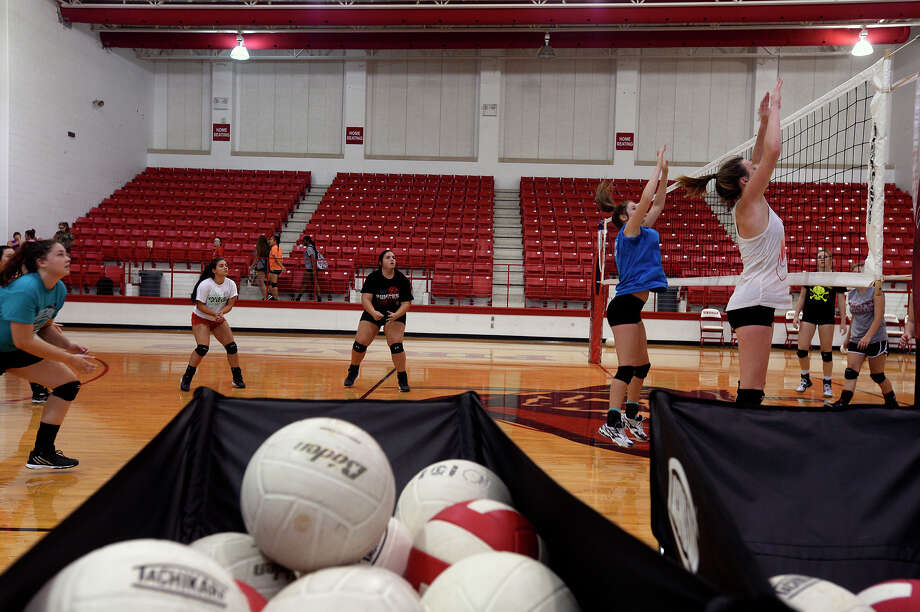 Deweyville volleyball players practice in the school's gym on Monday afternoon.  Photo taken Monday 8/8/16 Ryan Pelham/The Enterprise Photo: Ryan Pelham / ©2016 The Beaumont Enterprise/Ryan Pelham