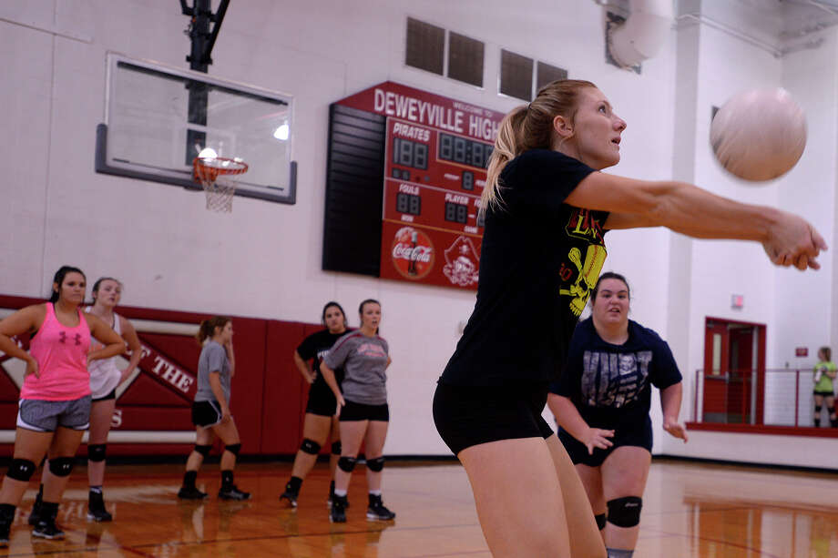 Senior Kennidee Willis bumps the ball during volleyball practice at Deweyville High School on Monday afternoon.  Photo taken Monday 8/8/16 Ryan Pelham/The Enterprise Photo: Ryan Pelham / ©2016 The Beaumont Enterprise/Ryan Pelham