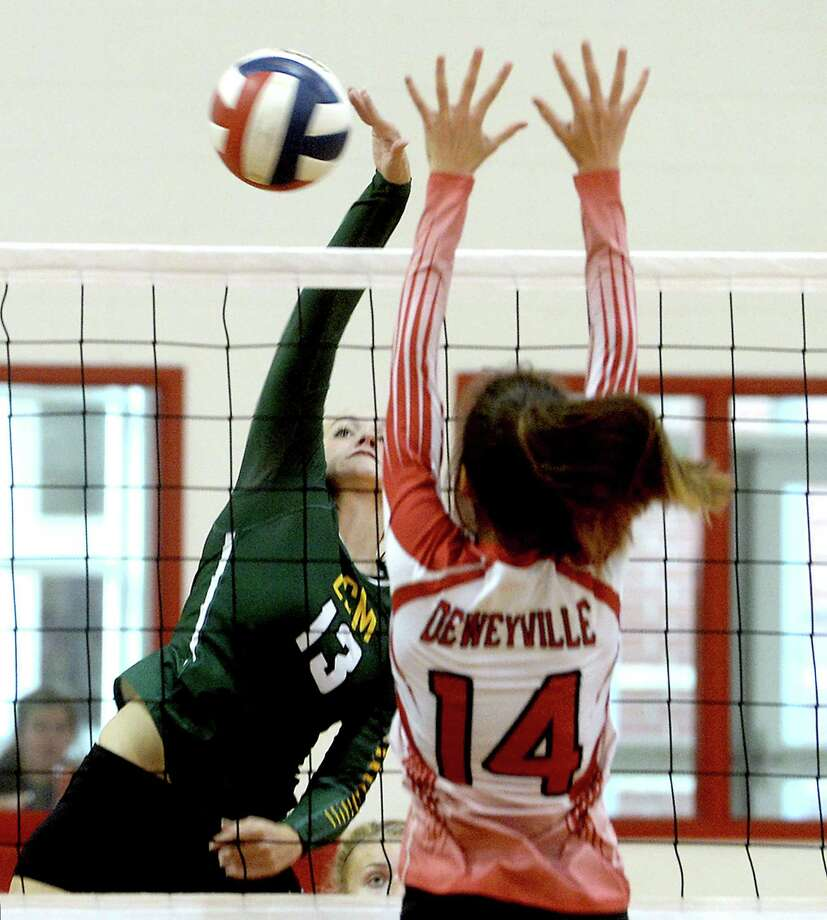 Little Cypress - Mauriceville's Madison Taggart returns as Deweyville's Grace Nicholson defends at the net during Tuesday night's season opening volleyball match-up at Deweyville High School. Photo taken Tuesday, August 9, 2016 Kim Brent/The Enterprise Photo: Kim Brent / Beaumont Enterprise