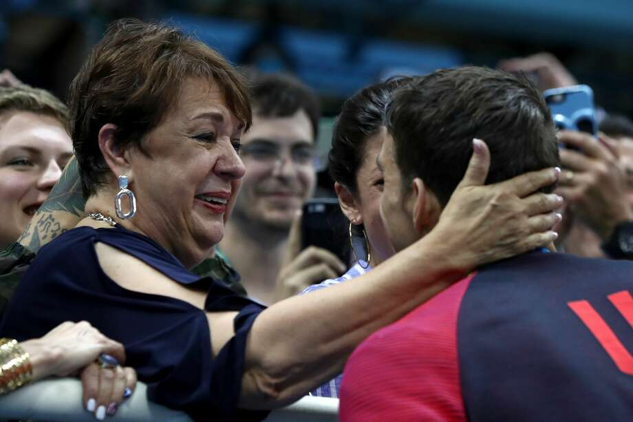 Athlete:Michael PhelpsCounty:United States of AmericaEvent:200m Butterfly FinalGold medalist Michael Phelps of the United States celebrates with his mother Deborah Phelps after the medal ceremony for the Men's 200m Butterfly Final on Day 4 of the Rio 2016 Olympic Games at the Olympic Aquatics Stadium on August 9, 2016 in Rio de Janeiro, Brazil. Photo: Al Bello/Getty Images