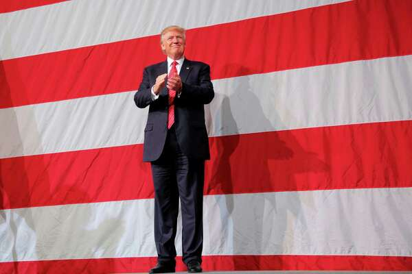 Donald Trump appears at at a rally at the Crown Coliseum in Fayetteville, N.C., on Tuesday. At an event earlier Tuesday in Wilmington, Trump appeared to raise the possibility that gun rights supporters could take matters into their own hands if Hillary Clinton is elected president.