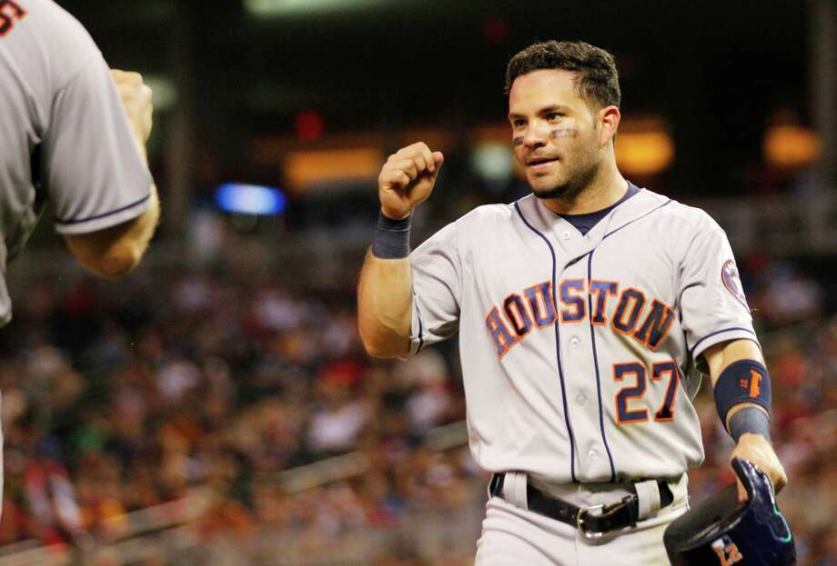 Houston Astros second baseman Jose Altuve is congratulated after scoring against the Minnesota Twins during the sixth inning of a baseball game Tuesday, Aug., 9, 2016, in Minneapolis. The Astros defeated the Twins 7-5. (AP Photo/Andy Clayton-King) Photo: Andy Clayton-King, Associated Press / FR51399 AP