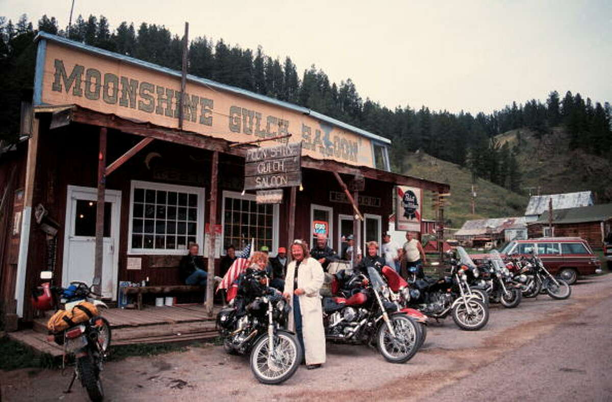 50th Anniversary of the World Famous Sturgis Motorcycle Rally. Group of bikers on their way to the Sturgis Rally stop at the Moonshine Gulch Saloon In Rochford, South Dakota on August 6, 1990. (Photo by Jim Steinfeldt/Michael Ochs Archives/Getty Images)