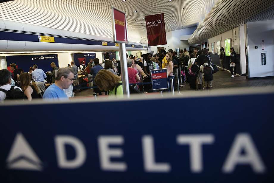 Passengers wait in line to speak with Delta Airline Inc. representatives at LaGuardia Airport in the Queens borough of New York, U.S., on Monday, Aug. 8, 2016. About 300 flights were scrapped after Delta Air Lines Inc. struggled to restart its worldwide operations after a computer failure halted flights for hours and grounded thousands of passengers. Photo: Victor J. Blue, Bloomberg