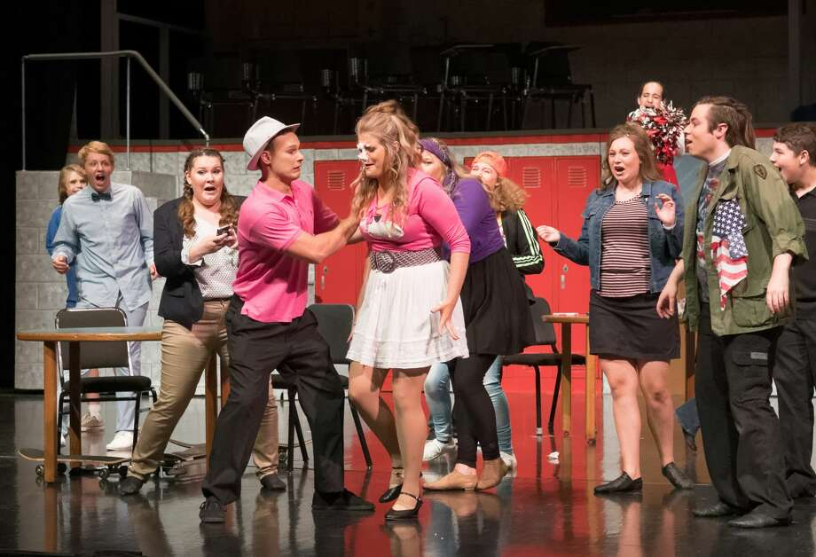 "Joe Fillmore as Ryan and Kady Booth as Sharpay at a rehearsal run of the TMI production of ""High School Musical"" at Midland Center for the Arts Tuesday evening. Photo: Steven Simpkins, Steven Simpkins For The Daily News"