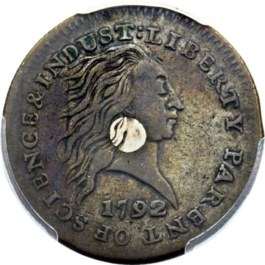 """This image shows the front of a 1792 """"Silver Center Cent."""" The 1-cent coin is one of two rare coins made during the early days of the U.S. Mint. The rare coins are anticipated to sell for nearly a million dollars at the World's Fair of Money in Anaheim, Calif., during a public auction. Photo: Heritage Auctions, HA.com / Heritage Auctions, HA.com"""