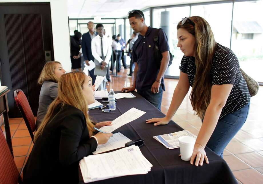 Claudia Caballero, district manager for Aldi (left) talks with job applicant Raisa Rickie at a job fair in Miami Lakes, Fla. The number of job openings rose a modest 2 percent to 5.6 million in June while hiring increased 1.7 percent in June to 5.1 million, the Labor Department said. Photo: Lynne Sladky /Associated Press / Copyright 2016 The Associated Press. All rights reserved. This material may not be published, broadcast, rewritten or redistribu