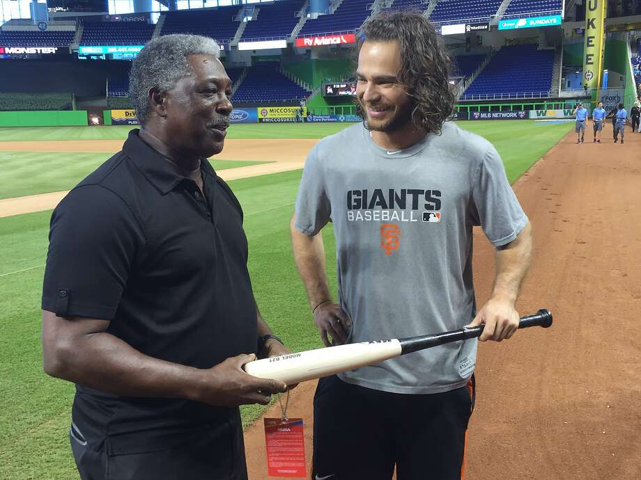 Brandon Crawford and Rennie Stennett, the last two major-leaguers to have seven hits in a game, chat at Marlins Park on Wednesday morning. Photo: Henry Schulman, San Francisco Chronicle