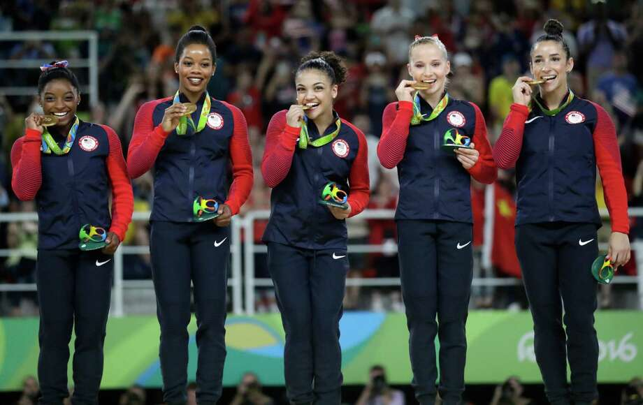 U.S. gymnasts, left to right, Simone Biles, Gabrielle Douglas, Lauren Hernandez, Madison Kocian and Aly Raisman hold their gold medals during the medal ceremony for the artistic gymnastics women's team at the 2016 Summer Olympics in Rio de Janeiro, Brazil, Tuesday, Aug. 9, 2016. The gymnasts made sure they knew where their gold medals were located when the team was forced to evacuate the building due to a fire alarm. Photo: Julio Cortez /Associated Press / Copyright 2016 The Associated Press. All rights reserved. This material may not be published, broadcast, rewritten or redistribu