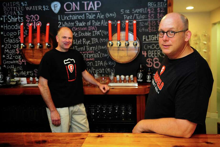 Brewmasters and owners Joseph Bow, left, and Mike Borruso at Fairfield Craft Ales on Honeyspot Road in Stratford, Conn., on Thursday Aug. 4, 2016. The micro brewery, which opened on July 9th, has created a line of music inspired beers like Quadrophenia Belgian Quad, Live & Let Rye and Revolution IPA. Photo: Christian Abraham / Hearst Connecticut Media / Connecticut Post