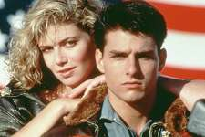 "Tom Cruise and Kelly McGillis star in the 1986 military film ""Top Gun."" American actors Tom Cruise, as Lieutenant Pete 'Maverick' Mitchell, and Kelly McGillis, as Charlotte 'Charlie' Blackwood, in a promotional portrait for 'Top Gun', directed by Tony Scott, 1986. (Photo by Paramount Pictures/Archive Photos/Getty Images)"