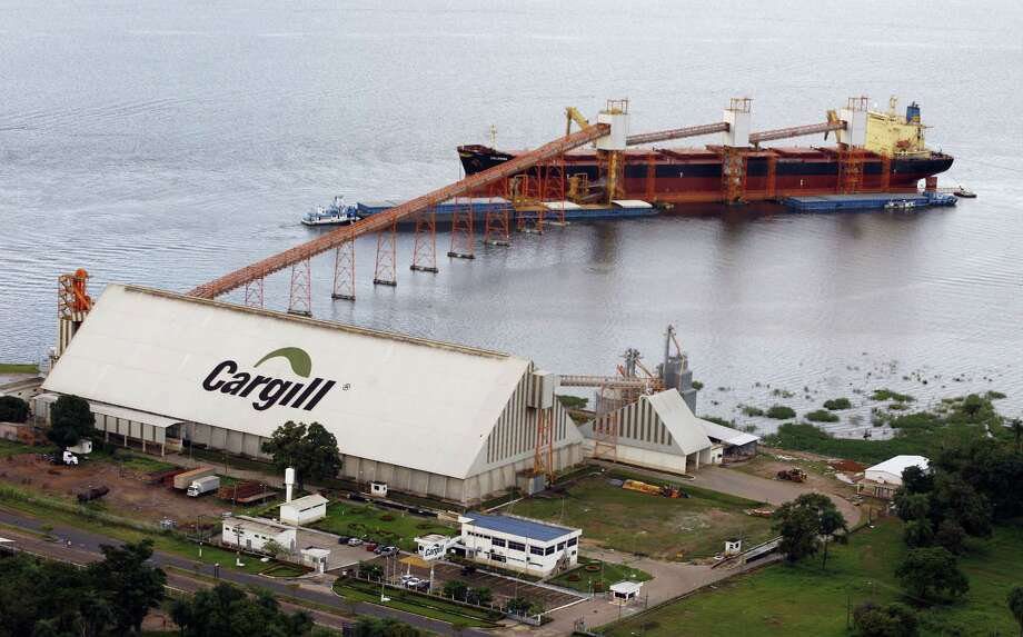 The Swiss-flag ship Celerina is loaded with over 50,000 tons of soy for Holland at the Cargill port in Santarem, Brazil. Cargill posted a fourth-quarter adjusted operating loss of $19 million partly because of wrong-way bets in soybean markets. Photo: Associated Press /File Photo / AP