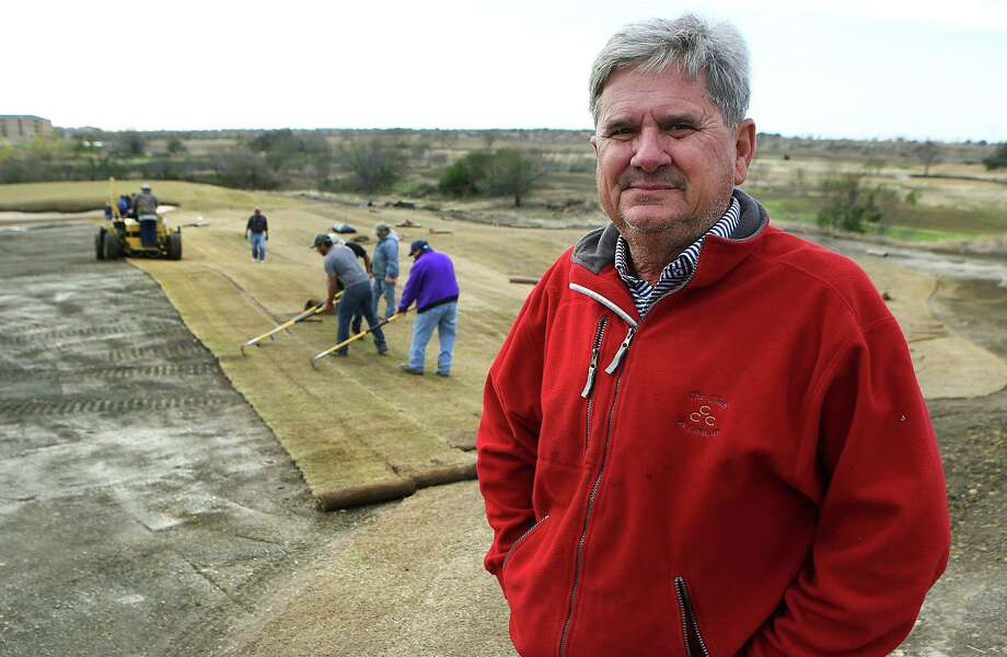 David Doguet, president of Bladerunner Farms in Poteet, oversees the laying down of Zoysia grass at Golf Club of Texas, of which he is part owner, on Jan. 7, 2015. His Zeon Zoysia grass was selected to be used on the golf course in Rio for the 2016 Olympics. Photo: Bob Owen /San Antonio Express-News / © 2014 San Antonio Express-News