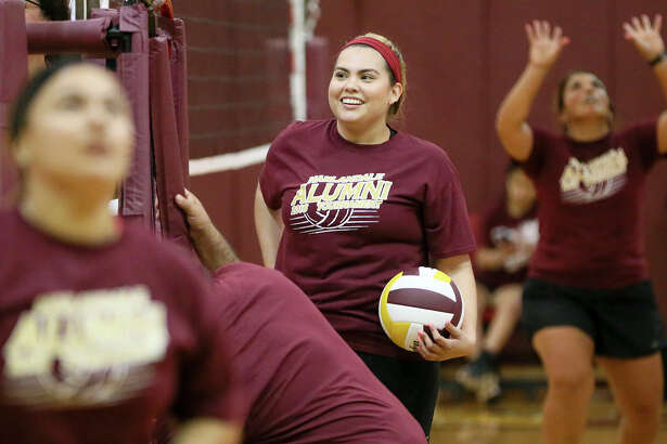Stephanie Velasquez prepares to play in the 2016 Harlandale Alumni Volleyball Tournament at Harlandale Hiigh School on Saturday, July 23, 2016.  Velasquez, from the class of '07, suffered a stroke in 2014 and was able to rejoin her teamates in the tournament for the first time this year.  MARVIN PFEIFFER/ mpfeiffer@express-news.net