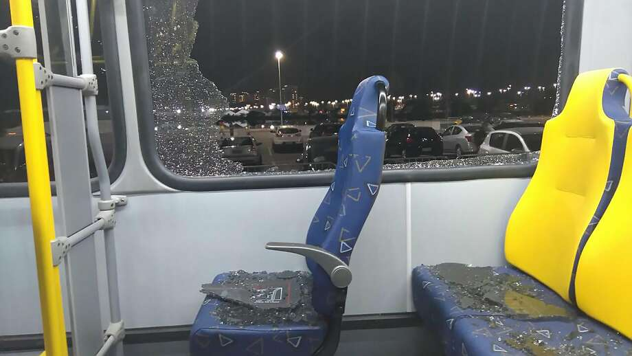 The damages to the window of an Olympic media bus hit while driving on the Transolympica Highway on Tuesday. Photo: GASTON SAINZ, AFP/Getty Images