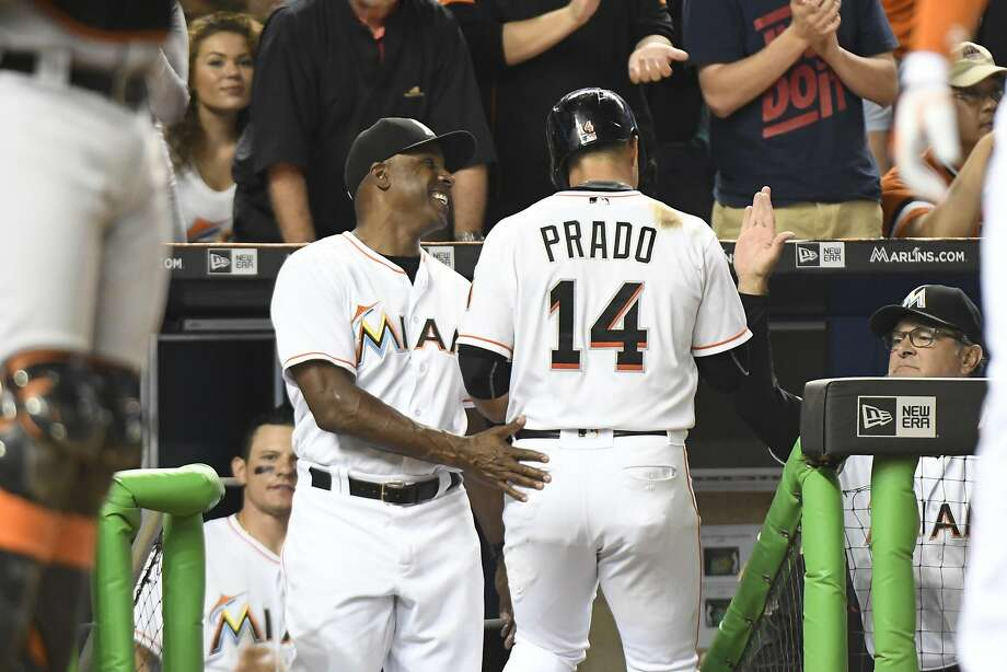 MIAMI, FL - AUGUST 08: Barry Bonds #25 of the Miami Marlins congratulates Martin Prado #14 after scoring on double by Christian Yelich #21 against the San Francisco Giants at Marlins Park on August 8, 2016 in Miami, Florida. (Photo by Eric Espada/Getty Images) Photo: Eric Espada, Getty Images