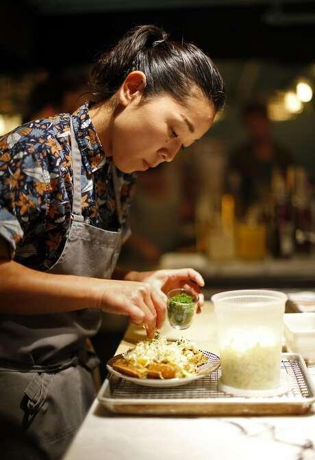 Sanae Shikayama prepares an okonomiyaki waffle at Louie's Gen-Gen Room in S.F. Photo: Scott Strazzante, The Chronicle