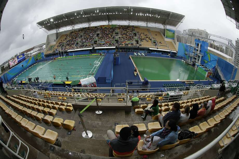 The water polo pool (left) starts to turn green. The diving pool (right) is entirely green. Photo: Matt Dunham, Associated Press