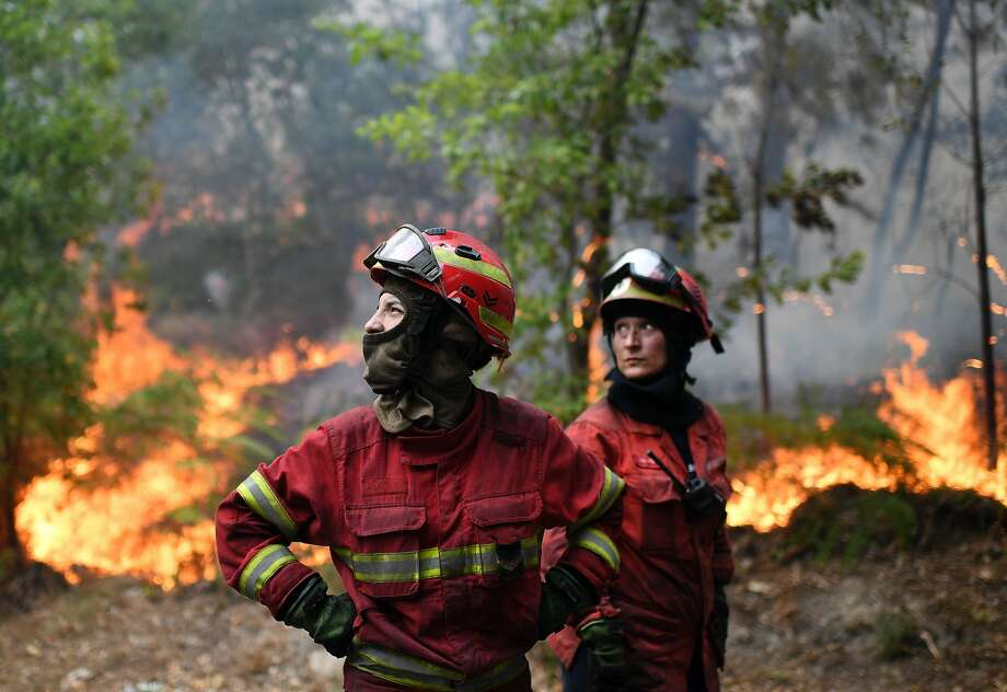 Firefighters survey the scene as they prepare to tackle the blaze in central Portugal on Tuesday. Photo: FRANCISCO LEONG, AFP/Getty Images