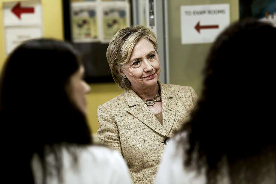 Hillary Clinton, the Democratic presidential nominee, greets members of the staff as she tours the Borinquen Health Care Center in Miami, Aug. 9, 2016. A new batch of State Department emails released Tuesday showed the close and sometimes overlapping interests between the Clinton Foundation and the State Department when Clinton served as secretary of state. (Scott McIntyre/The New York Times) Photo: SCOTT MCINTYRE, NYT