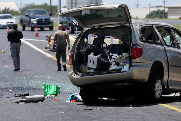 Police investigate the scene of a rollover van accident Wednesday August 10, 2016 on eastbound Loop 1604 at the off ramp to Bandera Road. Police at the scene said a man in his 80s was driving the vehicle and suffered a wound to the head. A woman in her 70s was also injured in the accident police said.
