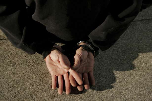 SAN BRUNO, CA - NOVEMBER 27:  A man is handcuffed after he was arrested by San Bruno police officers for driving under the influence of narcotics at a DUI checkpoint on November 27, 2006 in San Bruno, California. San Francisco Bay Area law enforcement agencies have begun to set up DUI checkpoints as the holiday season gets underway.  (Photo by Justin Sullivan/Getty Images)