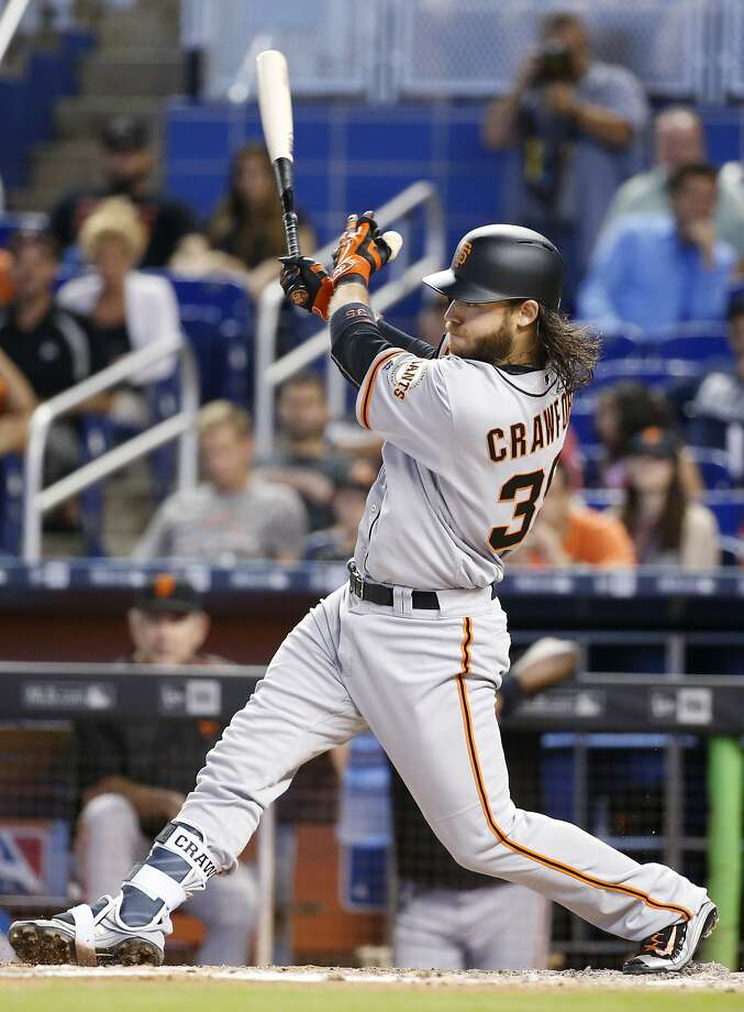 The lone run was supplied by the only Giant who had a decent road trip: Brandon Crawford, who connected for a fourth-inning home run off David Phelps. Photo: Wilfredo Lee, Associated Press