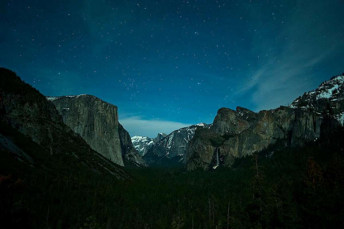 Time-lapse photograph of night sky over Yosemite Valley. Photographer Tony Rowell says most time-lapse photographs to capture stars and meteors are exposed for 5 to 20 seconds.