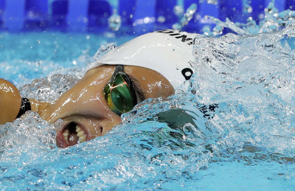 Yusra Mardini, swimming for the Refugee Olympic Team, competes in a heat of the women's 100-meter freestyle during the swimming competitions at the 2016 Summer Olympics, Wednesday, Aug. 10, 2016, in Rio de Janeiro, Brazil. (AP Photo/Lee Jin-man)