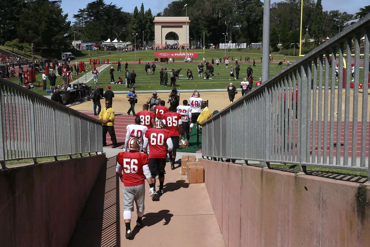 Players take the field as the San Francisco 49ers hold a practice open to the public, at Kezar Stadium in San Francisco , California, on Wed. Aug. 10, 2016.