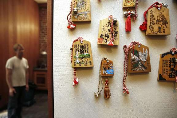 Details of wooden passes hanging in the bathroom walls of Onsen Holistic Spa in the Tenderloin on Tuesday, August 9, 2016, in San Francisco, Calif.